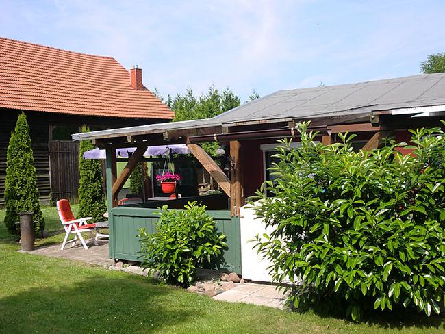 Ferienhaus überdachte Terrasse mit Tür
