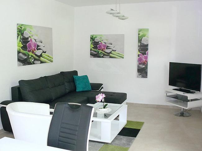 Ferienhaus Wohnzimmer mit Sitzecke