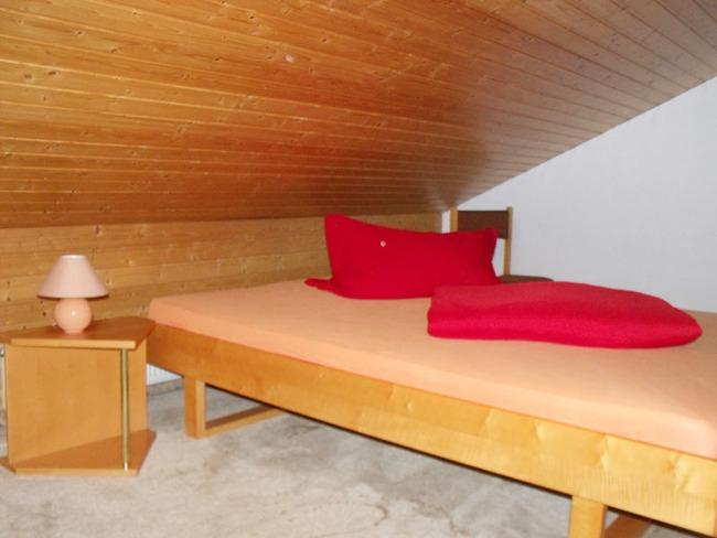 Ferienwohnung - Schlafzimmer im Dachgeschoss