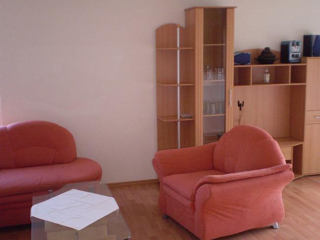 Ferienwohnung - Wohnraum mit Couchecke