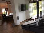 Ferienhaus Alter Apfelbaum - Wohnraum mit Couchecke und TV
