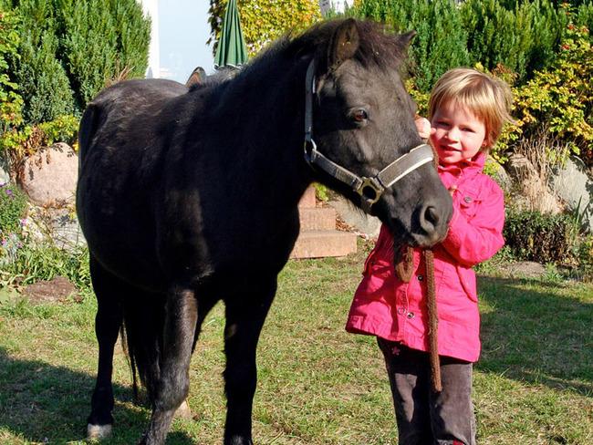 Kind mit einem Pony