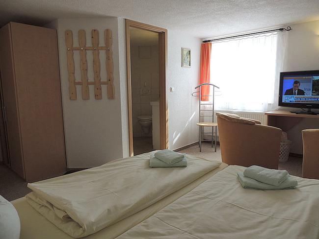 Doppelzimmer 1 Bett, Sitzecke und Bad