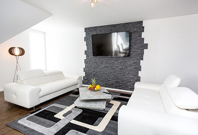 Fewo Meersinn - Wohnraum mit Couchecke und TV