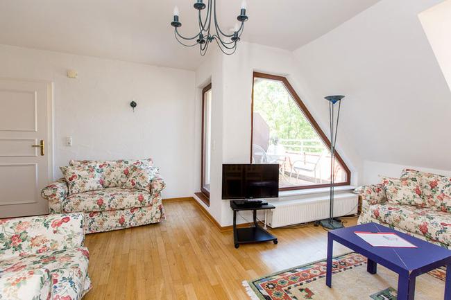 Appartement 5 - Wohnbereich mit gemütlichen Sofa