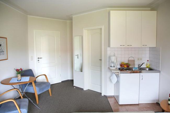 Doppelzimmer mit Koch- und Sitzecke