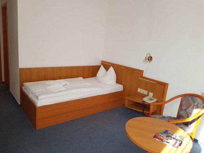 Einzelzimmer mit Sitzecke