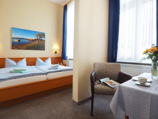 Appartement mit Doppelbett und Sitzecke