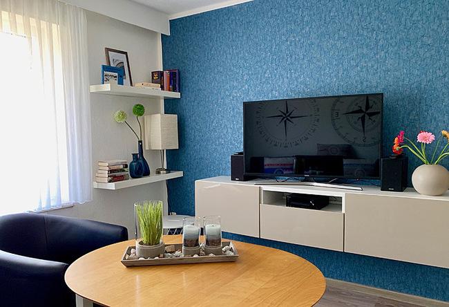 Wohzimmer mit Sitzecke & TV