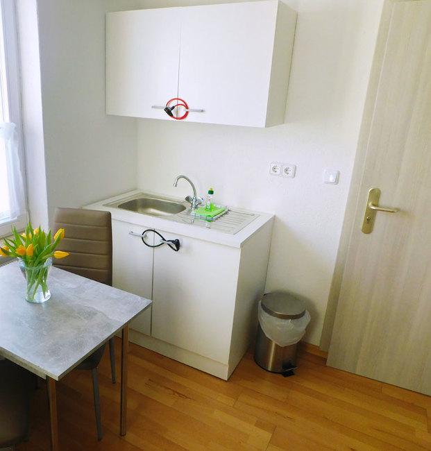 Dreibettzimmer mit Miniküche